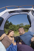 Couple in tent looking at each other — Stock Photo