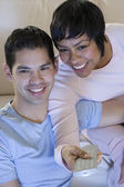 Hispanic couple watching television — Stock Photo