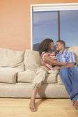 Couple together on couch — Stock Photo