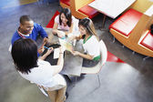 Teenagers ordering at restaurant — Stock Photo