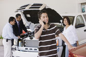 Hispanic family at car dealership — Stock Photo