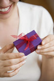 Woman holding small present — Stock Photo