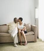 Senior African woman kissing husband on cheek — Stock Photo