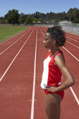 Portrait of female track and field participant — Stock Photo