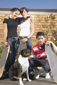 Teenagers holding skateboards — Stock Photo