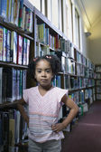 Portrait of girl at library — Stock Photo