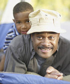African father and son smiling — Stock Photo