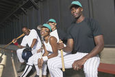 Portrait of baseball team in dugout — Stock Photo