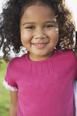 Portrait of young girl smiling — Stock Photo