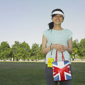 Asian woman holding shopping bag — Stock Photo