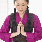 Asian woman saying prayers — Stock Photo