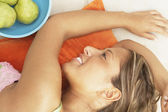 Close up of young woman lying down — Stock Photo