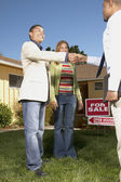 Couple with realtor at open house — Stock Photo