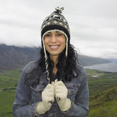 Hispanic woman wearing hat and gloves — Stock Photo