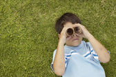 Young boy looking through toy binoculars — Stock Photo