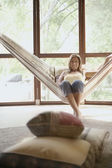 Portrait of woman on hammock — Stock Photo
