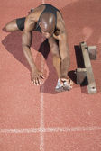 High angle view of man stretching on track — Stock Photo