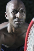 Portrait of man playing tennis — Stok fotoğraf