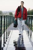 Man walking over bridge — Stock Photo