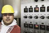 Man beside control panel — Stock Photo