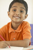 Portrait of Indian boy drawing — Stock Photo
