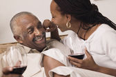 Couple hugging and drinking wine — Stock Photo