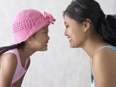 Portrait of mother and daughter kissing — Stock Photo