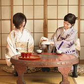 Two Asian women drinking tea — Stock Photo