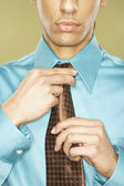 Middle Eastern businessman adjusting necktie — Stock Photo