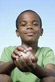 African boy holding baseball — Stock Photo