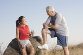 Senior couple resting during a workout — Stock Photo