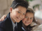 Portrait of girl and boy smiling — Stock Photo
