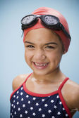 Hispanic girl in bathing suit with goggles and swim cap — Stock Photo