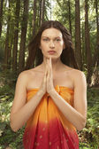 Woman in forest praying — Stock Photo