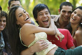 South American friends laughing — Stock Photo