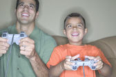 Father and son playing video games — Stock Photo