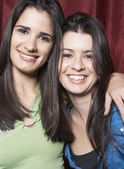 Sisters smiling for the camera — Stock Photo