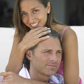 Young woman hugging her boyfriend — Stock Photo