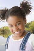 Close up of African American girl smiling — Stock Photo
