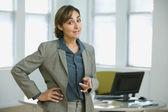 Hispanic businesswoman pointing — Stock Photo