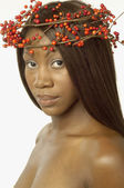 Young woman wearing crown of berries on her head — Stock Photo