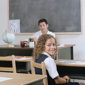 School girl sitting in class — Stock Photo
