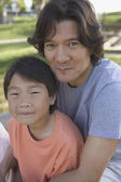 Portrait of father and son smiling — Stock Photo