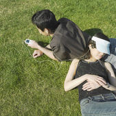 Young couple relaxing in grass — Stock Photo