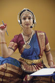 Indian woman in traditional dress using a headset — Stock Photo
