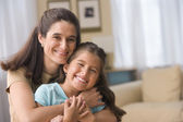 Portrait of mother hugging daughter — Stock Photo