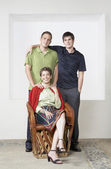 Portrait of Hispanic mother and adult sons — Stock Photo