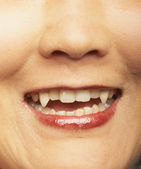 Close up of vampire fangs — Stock Photo