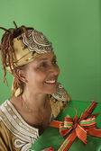 Woman with wrapped gift — Stock Photo