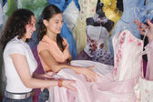 Hispanic girls looking at Quinceanera dress — Stock Photo